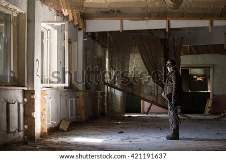 a man with a gun in abandoned house