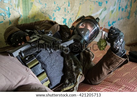 a man with a gun in abandoned house, on the mattress