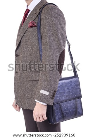 A man with a handbag in his hand - stock photo