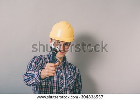 a man with a helmet with a wrench