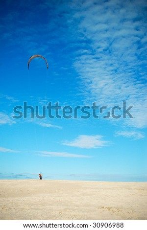 A man with a kite at Slowinski National Park sand dunes. Poland.