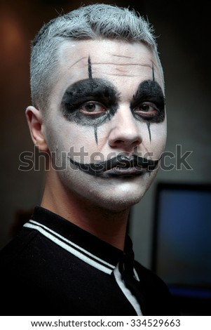 A man with a make-up for Halloween