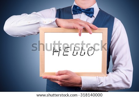 a man with a sign in his hand that says hello - stock photo