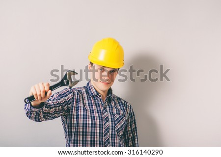 a man with a wrench in his helmet.