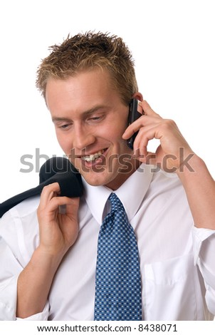 A man with his jacket over his shoulder making a call - stock photo