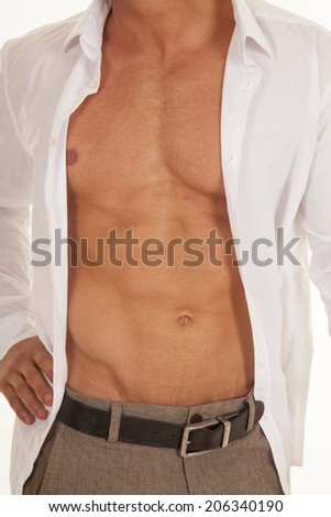 a man with his white shirt unbuttoned close up of his chest - stock photo