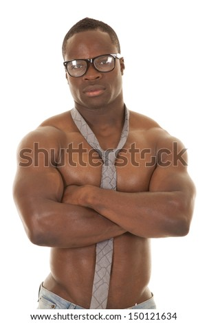 a man with no shirt on wearing a neck tie and glasses, showing off his muscles. - stock photo