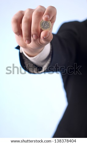A man with one euro coin - stock photo