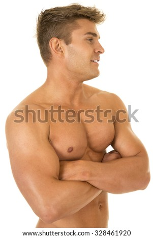 a man with out a shirt on looking to the side.