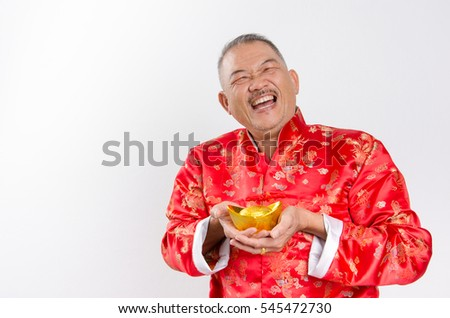 A man with red packets for Chinese New Year