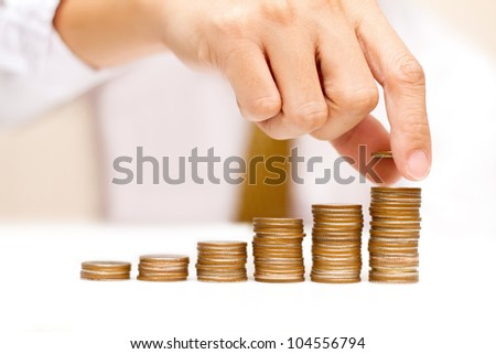 a man with rising coins - stock photo