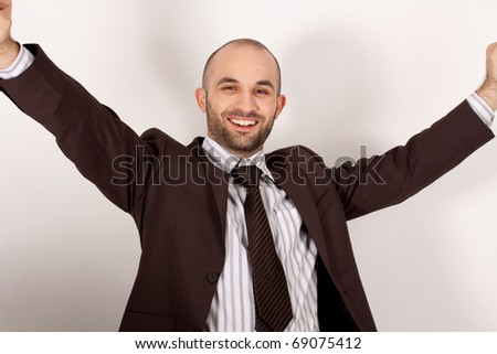 A man with suit is happy - stock photo