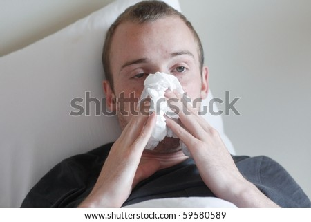 A man with the flu - stock photo