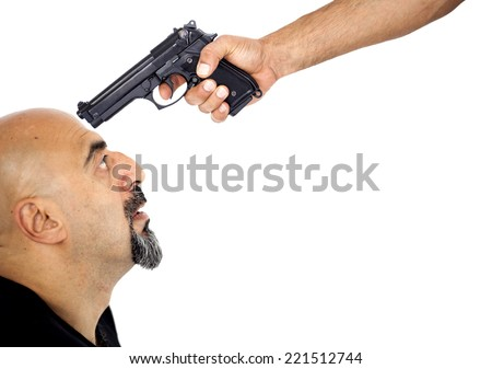 A man with the gun his head - stock photo
