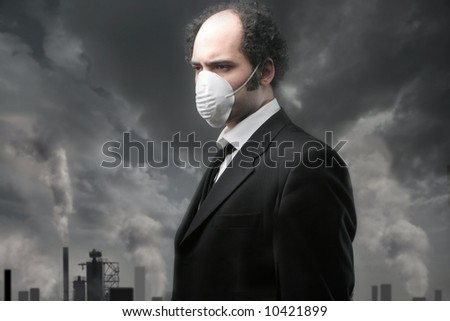 a man with the mask for the smog - stock photo
