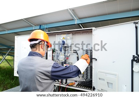 A  man  working at solar panels.