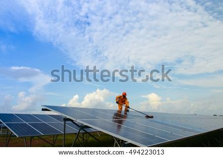 A  man  working  on solar panels.