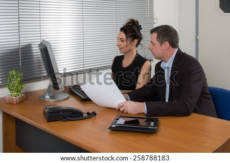 a manager  and  his secretary a  business team