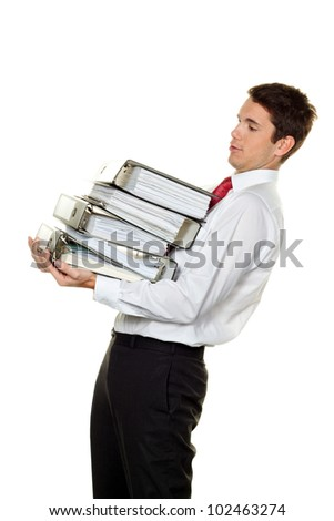 a manager in trouble with stacks of files. bureaucracy in administration - stock photo