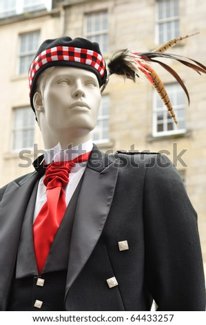 A manequin dressed in traditional Scottish attire. - stock photo