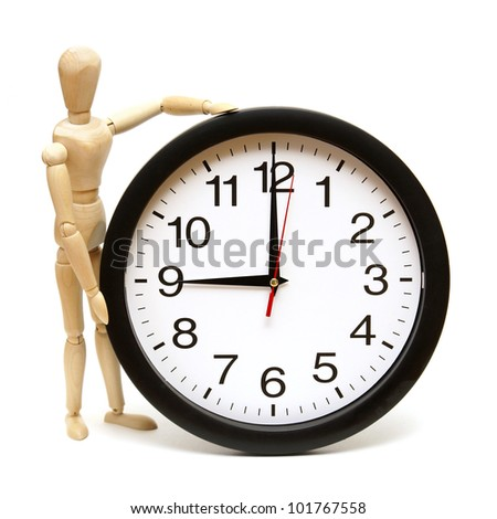 A mannequin and clock are isolated on white to represent time management. - stock photo