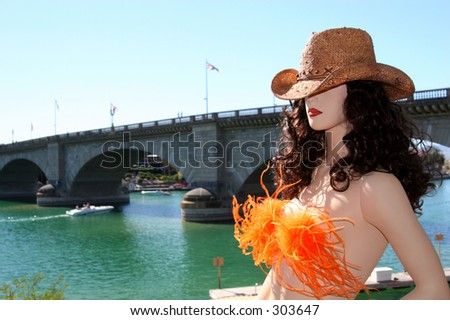 A mannequin with a cowboy hat on overlooks the London Bridge in Lake Havasu City, Arizona.