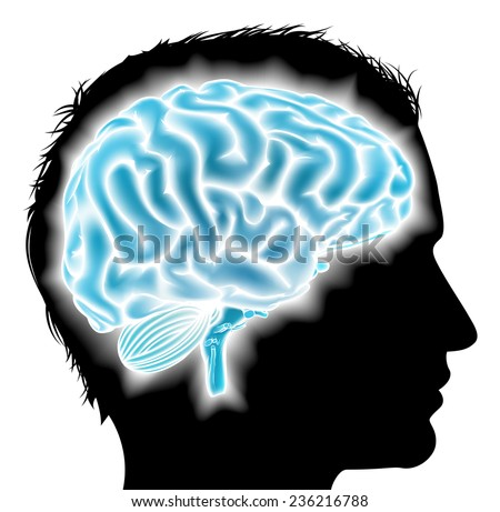 A mans head in silhouette with a glowing brain. Concept for mental, psychological development, brain development, learning and education, mental stimulation or other medical theme - stock photo