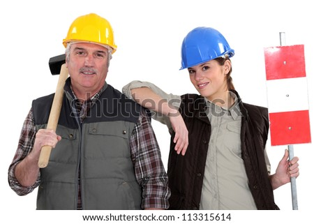 A manual worker and his trainee. - stock photo