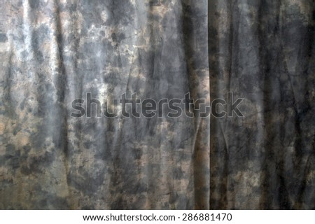 A marbled photographic backdrop fills the entire image with wrinkles and a fine crease. - stock photo