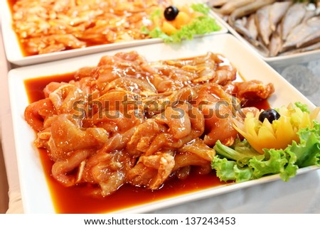A Marinated chicken on a white plat