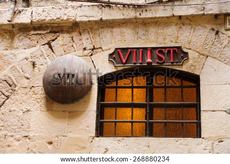 A mark of station 7 of the Via Dolorosa, in the old city of Jerusalem, Israel - stock photo