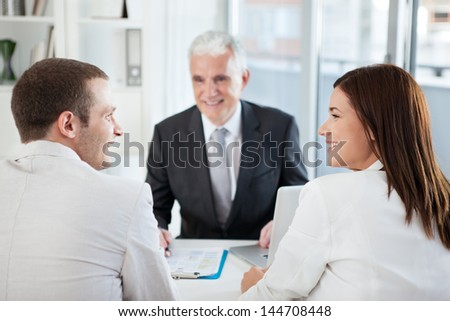 A married couple with their financial advisor. - stock photo