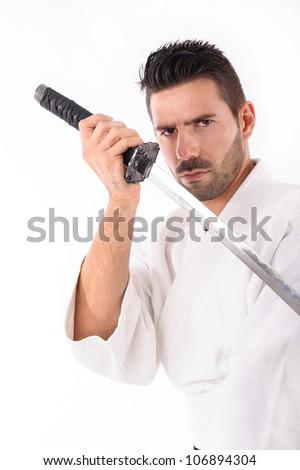 a martial arts man with a sword. Closeup studio portrait - stock photo