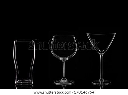 A Martini Glass, a Wine Glass and a Pint Glass on a Black Background