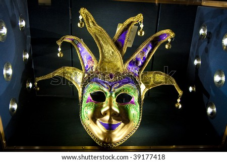 A mask for mardi gras or carnival in a black case