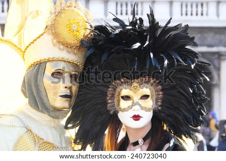 A masked couple exhibited during the traditional Carnival of Venice, Italy (2014 edition) - stock photo