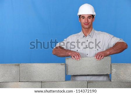 A mason placing a stone - stock photo
