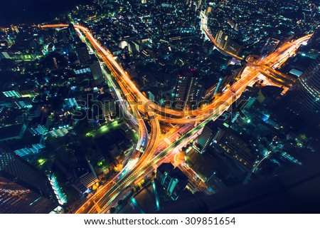 A massive highway intersection from above at night in Shinjuku, Tokyo, Japan - stock photo