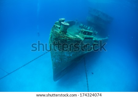 A massive shipwreck, the Kittewake, sits on a sandy seafloor in Grand Cayman. This ship was sunk intentionally to act as an artificial reef and as an attraction for scuba divers. - stock photo