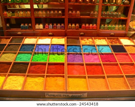a matrix of old fashioned artists colours used in oil painting.