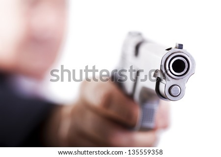 A mature adult man wearing a suit, holding a 9mm gun with his right hand, aiming it diagonally to the right. Isolated on white background. - stock photo