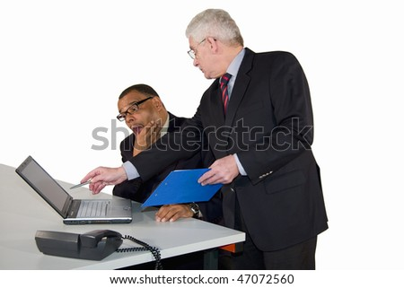 a mature African-American businessman having made a mistake and being strictly advised by his boss, a caucasian senior manager, isolated on white background - stock photo