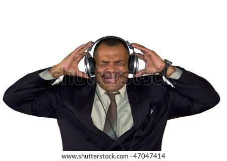 a mature African-American with headphones listening to bad sound and making faces, isolated on white background