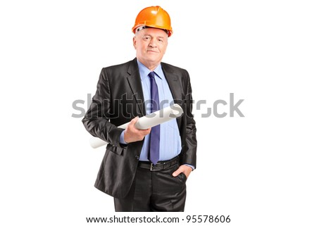 A mature construction worker with helmet holding blueprints isolated on white background