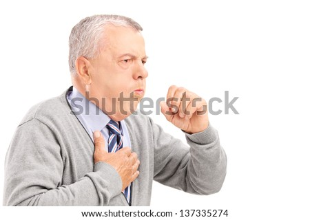 A mature gentleman coughing because of pulmonary disease isolated on white background - stock photo