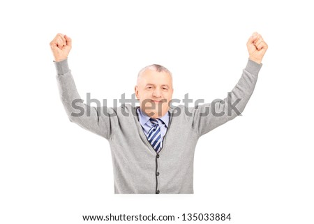 A mature gentleman seated on a table gesturing happiness isolated on white background - stock photo