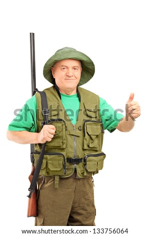 A mature hunter holding a rifle and giving a thumb up isolated on white background - stock photo