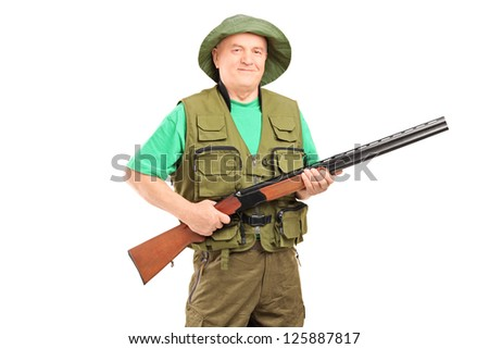 A mature male hunter holding a rifle isolated on white background