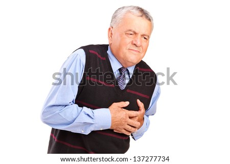 A mature man having a heart attack isolated on white background - stock photo