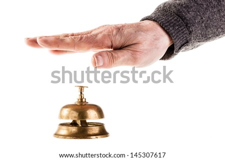 a mature old man ringing a hoted reception bell isolated over white